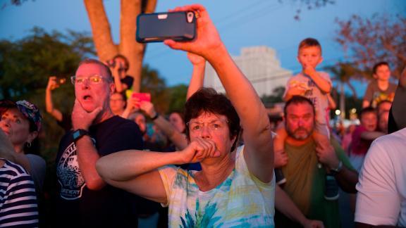 People capture the burn on their phones.