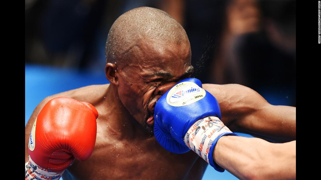 Moruti Mthalane of South Africa is punched by Masayuki Kuroda of Japan during their IBF flyweight title boxing bout in Tokyo on Monday, May 13.
