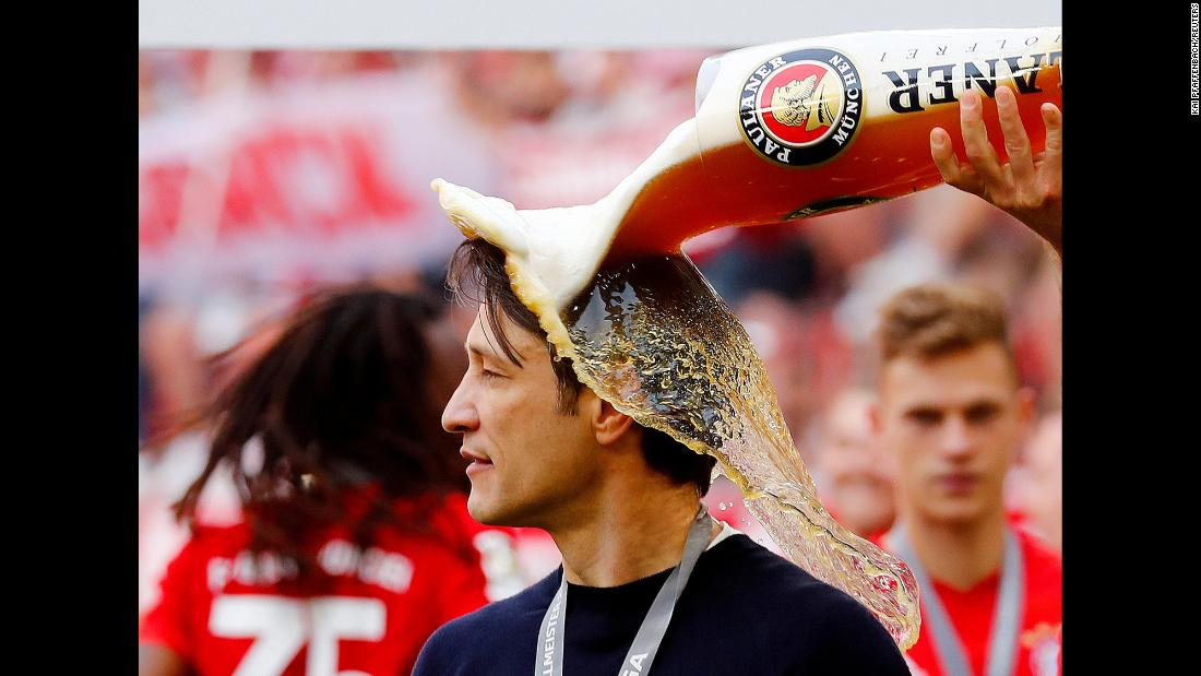 Bayern Munich player Arjen Robben pours beer on his coach Niko Kovac in celebration after defeating Eintracht Frankfurt to win the Bundesliga on Saturday, May 18 in Munich, Germany.