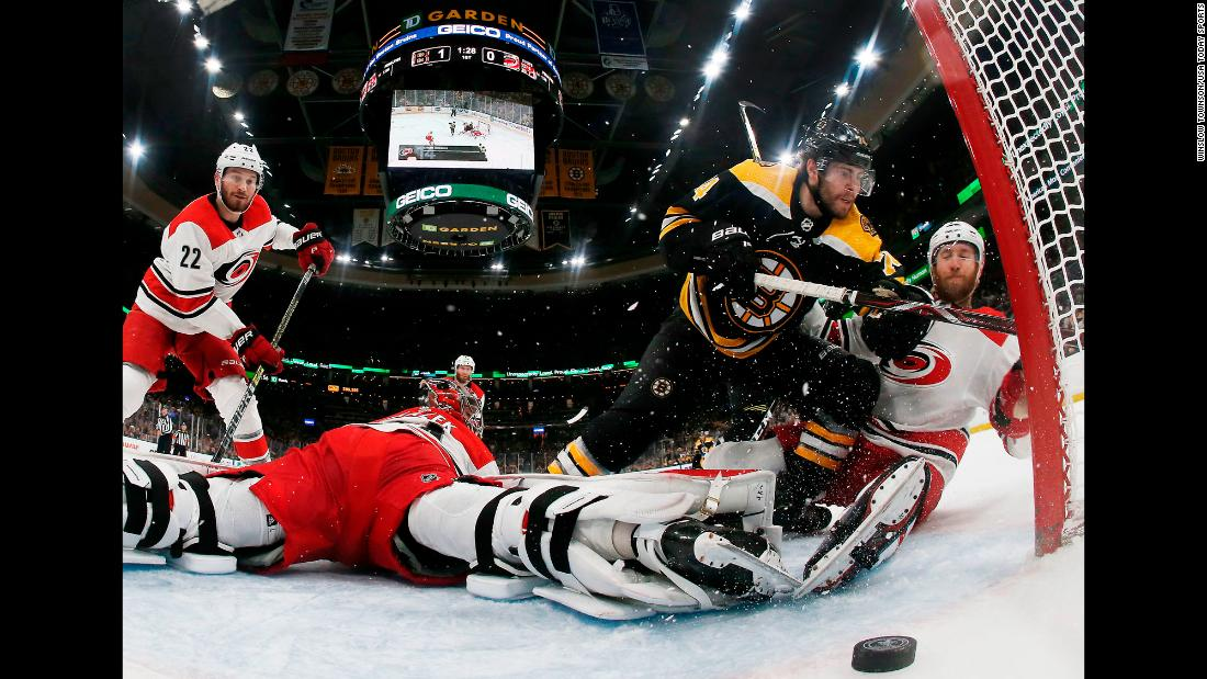 Boston Bruins left wing Jake DeBrusk, defended by Jaccob Slavin of the Carolina Hurricanes scores a goal during Game 2 of the Eastern Conference Final of the 2019 Stanley Cup Playoffs at TD Garden in Boston on Sunday, May 12.