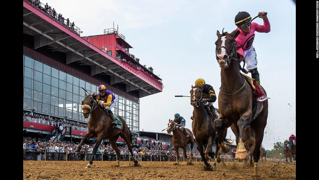 Tyler Gaffalione rides War of Will, right, to a first-place finish during the 144th running of the Preakness Stakes at Pimlico Race Course on Saturday, May 18.