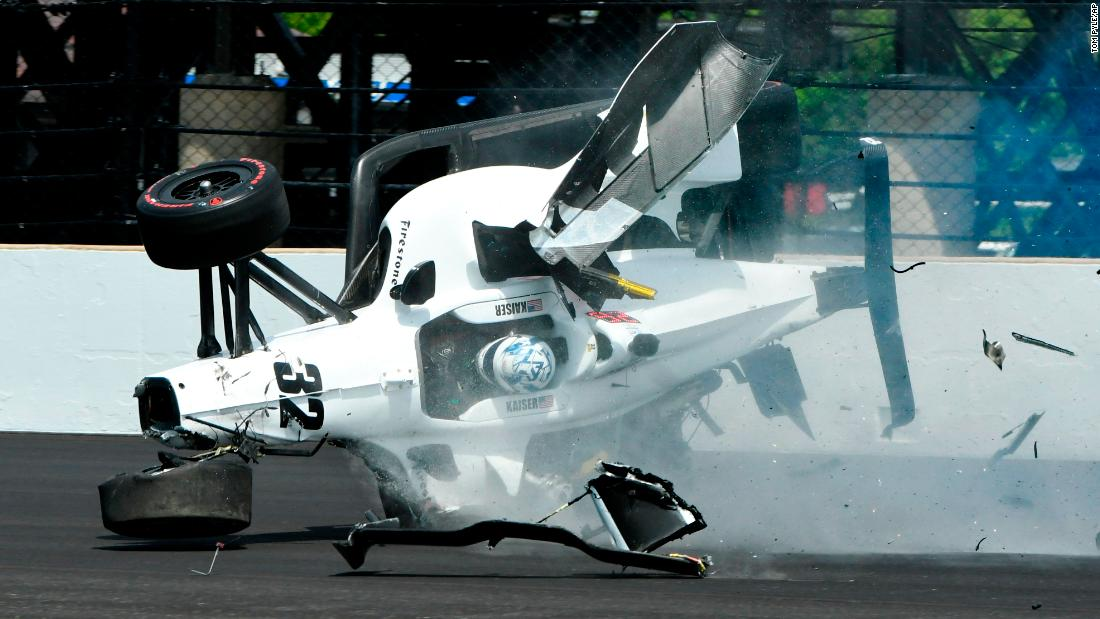 Kyle Kaiser crashes his car and goes airborne after hitting the wall along the third turn during practice for the Indianapolis 500 IndyCar auto race at Indianapolis Motor Speedway on Friday, May 17.