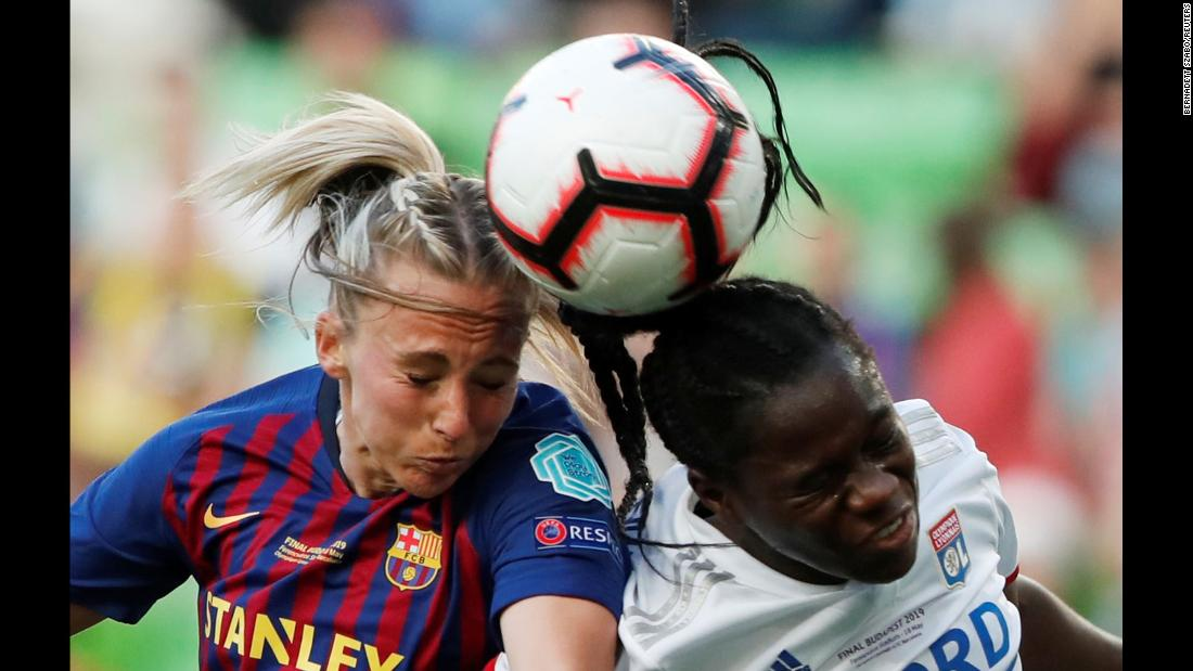 Barcelona's Toni Duggan competes for a ball with Olympique Lyonnais' Griedge Mbock during the Women's Champions League final on Saturday, May 18 in Budapest, Hungary.