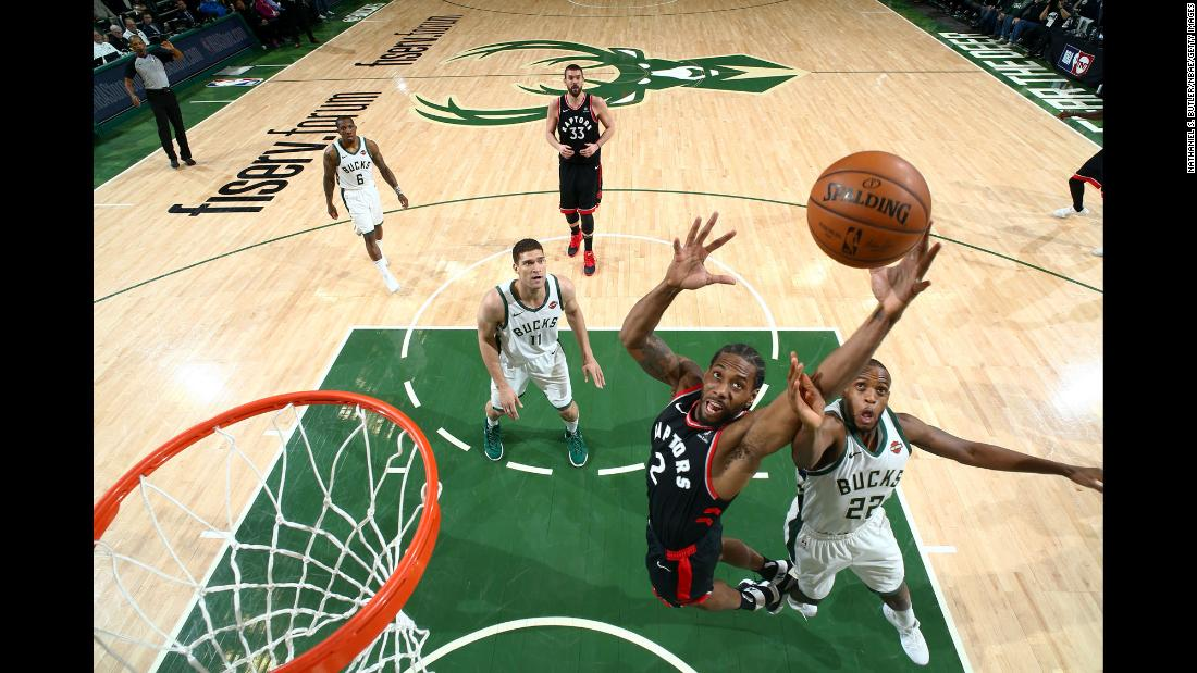 Kawhi Leonard of the Toronto Raptors and Khris Middleton of the Milwaukee Bucks compete for a rebound during Game 2 of the NBA Eastern Conference Finals on Friday, May 17 at Fiserv Forum in Milwaukee, Wisconsin.
