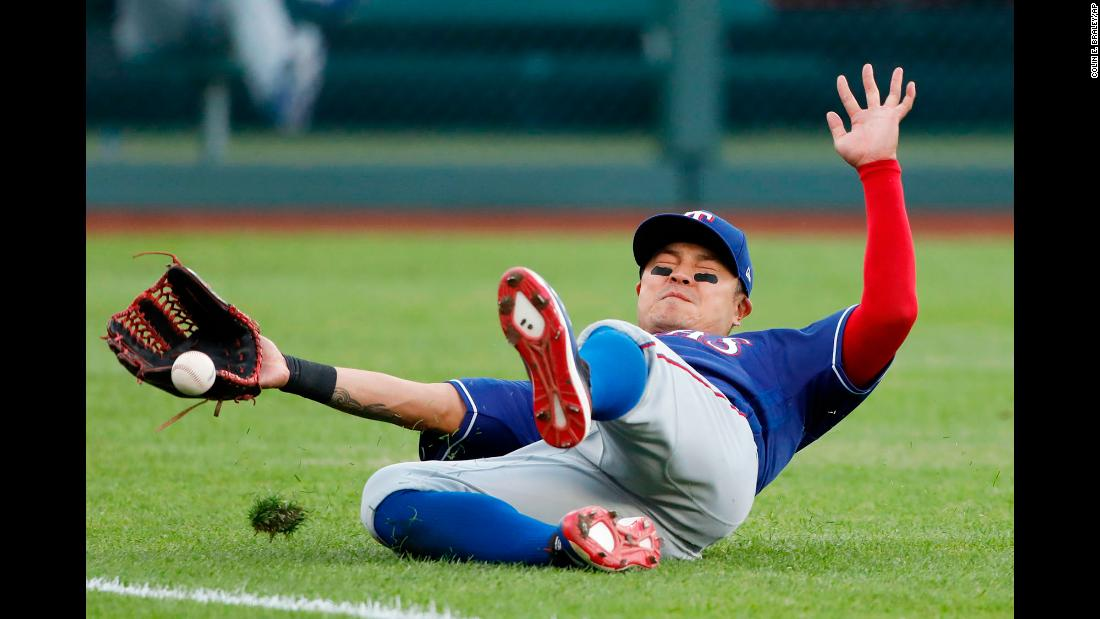 Texas Rangers left fielder Shin-Soo Choo misses a fly ball hit by Kansas City Royals' Alex Gordon during the first inning of a baseball game at Kauffman Stadium in Kansas City, Missouri on Tuesday, May 14.