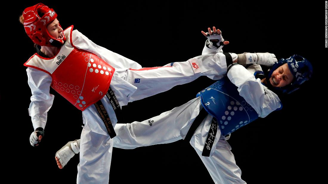 Rukiye Yildirim of Turkey, right, dodges a kick by Great Britain's Maddison Moore during their quarter final match on day three of the World Taekwondo Championships at Manchester Arena on Friday, May 17.