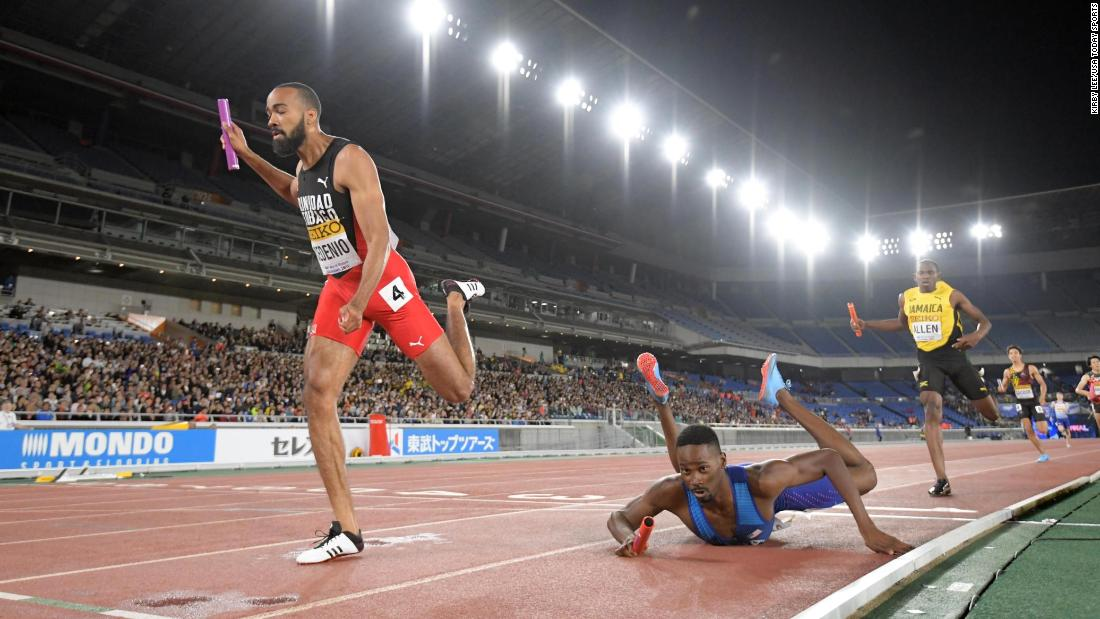 Paul Dedewo of the United States falls at the finish line attempting to beat Machel Cedenio (left) of Trinidad and Tobago during the 4 x 400m relay of the IAAF World Relays on Sunday, May 12 in Yokohama, Japan. The United States was disqualified.