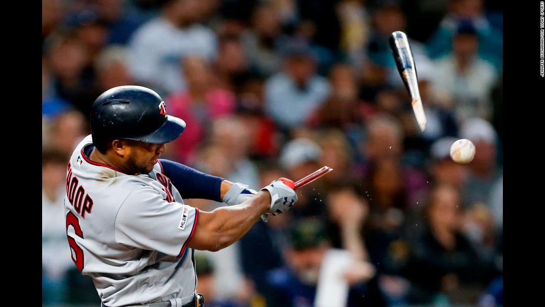 Minnesota Twins second baseman Jonathan Schoop breaks his bat during the fourth inning of a game against the Seattle Mariners during the fourth inning at T-Mobile Park on Saturday, May 18, in Seattle, Washington.