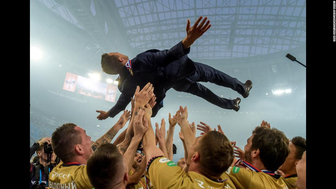 Zenit St. Petersburg players toss head coach Sergei Semak in the air after defeating CSKA Moscow for the Russian Premier League on Sunday, May 12, in St. Petersburg, Russia. The newly-crowned champions battled back from a goal down to beat CSKA Moscow 3-1.