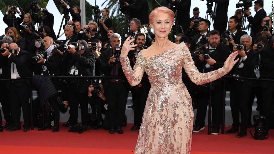 Helen Mirren, wearing Elie Saab, shows off bubblegum pink hair on the red carpet.