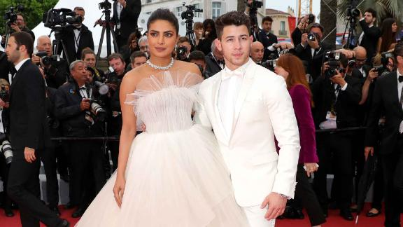 "Newlyweds Priyanka Chopra (wearing a strapless Georges Hobeika gown) and Nick Jonas attend the screening of ""Les Plus Belles Annees D"