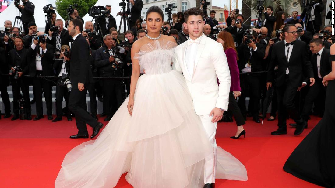 "Newlyweds Priyanka Chopra (wearing a strapless Georges Hobeika gown) and Nick Jonas attend the screening of ""Les Plus Belles Annees D'Une Vie."""