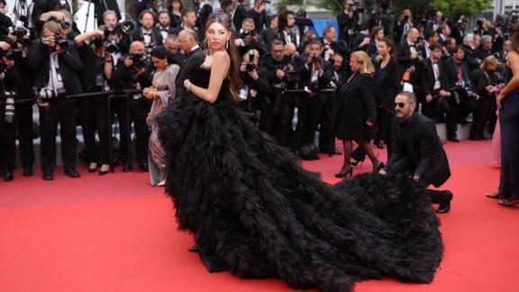 Singer Madison Beer gets a hand with her Georges Hobeika gown.