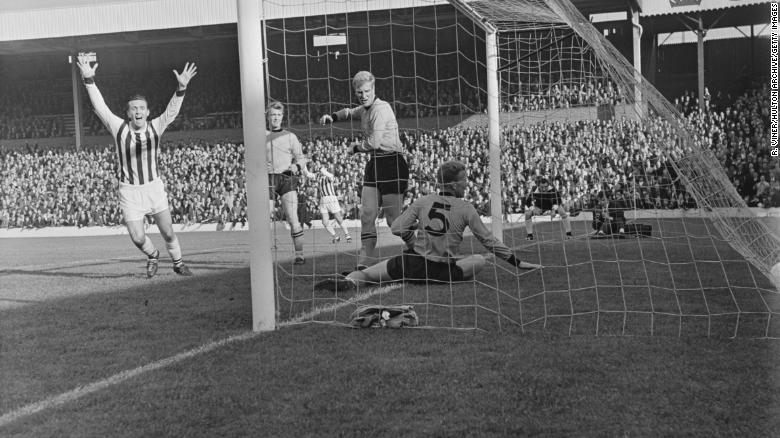 WBA's Jeff Astle of West scores against Wolves in October 1964.