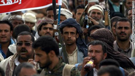 Cheeks are going out with khat are everywhere in Yemen, here are armed supporters of the Houthis chew at a rally in Sana'a in 2015.