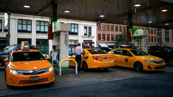 Taxi cabs fill up at a BP Gas station on the West Side of Manhattan, August 8, 2018 in New York City. (Photo by Drew Angerer/Getty Images)