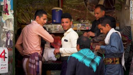 Young and old frequent market stalls selling khat in the capital Sanaa.