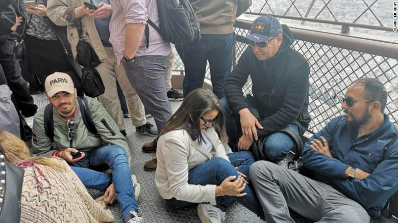 People were stuck on the Eiffel Tower after a person scaled the landmark.