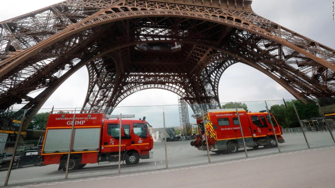 Eiffel Tower evacuated as man climbs the landmark