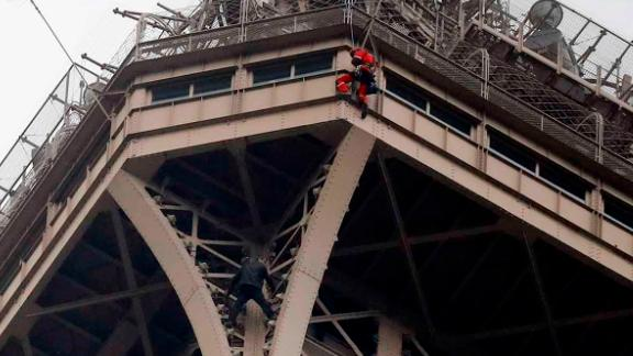 The Eiffel Tower has been closed to visitors after a man was seen scaling it.
