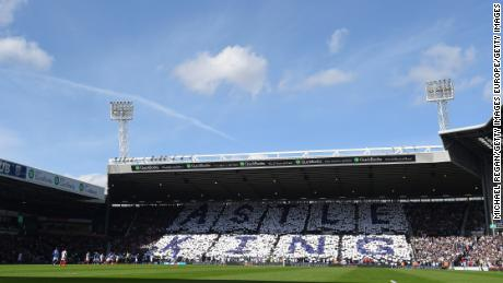 West Brom fans hold up cards in tribute to Jeff Astle.