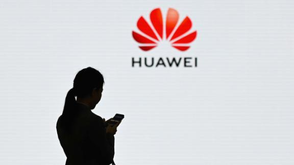 "A staff member of Huawei uses her mobile phone at the Huawei Digital Transformation Showcase in Shenzhen, China's Guangdong province on March 6, 2019. - Chinese telecom giant Huawei insisted on March 6 its products feature no security ""backdoors"" for the government, as the normally secretive company gave foreign media a peek inside its state-of-the-art facilities. (Photo by WANG ZHAO / AFP)        (Photo credit should read WANG ZHAO/AFP/Getty Images)"