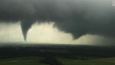 A tornado, left,  and a funnel cloud are seen near Crescent, Oklahoma. Both went on to become tornadoes, according to CNN's weather department.