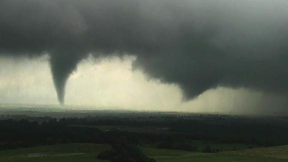 A tornado, left, and a funnel cloud take shape near Crescent, Oklahoma. Both became tornadoes, according to CNN Weather.