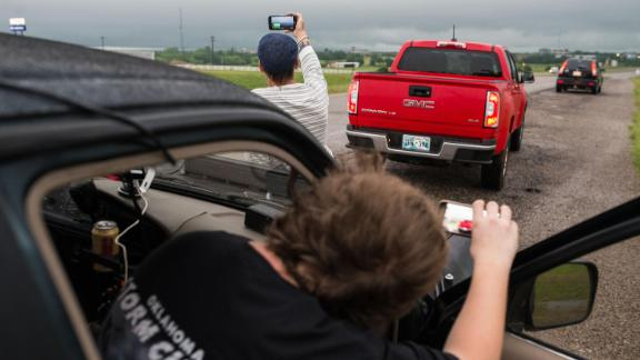 "Brandon Alexander, 18; and Daniel Brown, 48, are local storm chasers who followed the storm to Perry, Oklahoma. ""We've only been doing this for about a year,"" Brown said May 20."
