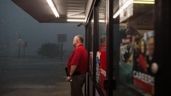 A worker at a gas station checks outside after a storm system passes in Perry, Oklahoma on May 20.