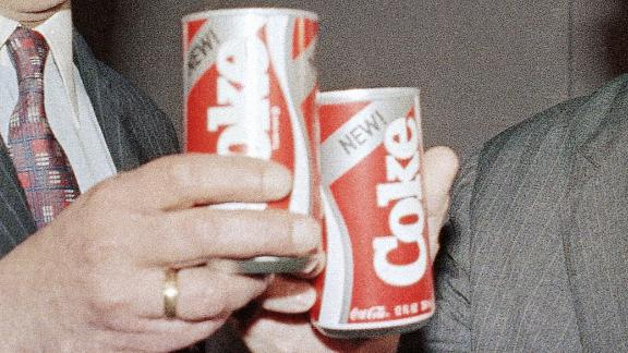 Robert C. Goizueta, Chairman of the Board and Chief Executive Officer, left, and Donald R. Keough, President and Chief Operating Officer, right, toast the New Coke after press presentation in Lincoln Center on April 23, 1985. (AP Photo/Marty Lederhandler)