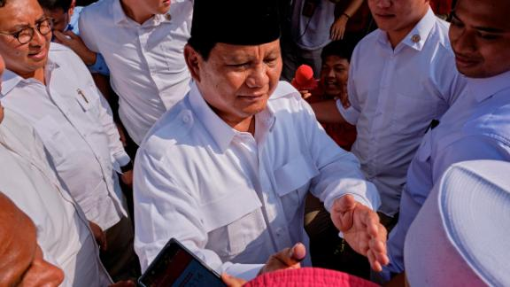 Indonesian Presidential candidate Prabowo Subianto shakes hands with voters after casting his vote at a polling station on April 17, 2019 in Babakan Madang, Indonesia.