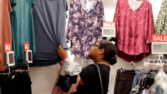 FILE- In this Aug. 28, 2018, file photo, Heather Camacuari shops for clothing at a Kohl's store in Concord, N.C. On Friday, Sept. 14, the Commerce Department releases U.S. retail sales data for August. (AP Photo/Chuck Burton, File)