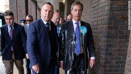 Brexit Party leader Nigel Farage (right) had a milkshake thrown at him while campaigning last month.