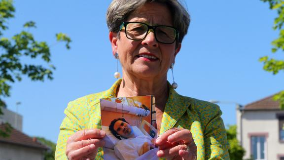 Vincent Lambert's mother, Viviane, holds a picture of her son.