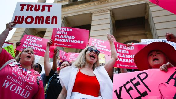 """ATLANTA, GA - MAY 21: People protest against Georgia's recently passed """"heartbeat"""" bill at the Georgia State Capitol building, on May 21, 2019 in Atlanta, Georgia. The bill would ban abortion when a fetal heartbeat is detected. The Alabama abortion law, signed by Gov. Kay Ivey last week, includes no exceptions for cases of rape and incest, outlawing all abortions except when necessary to prevent serious health problems for the woman. Though women are exempt from criminal and civil liability, the new law punishes doctors for performing an abortion, making the procedure a Class A felony punishable by up to 99 years in prison (Photo by Elijah Nouvelage/Getty Images)"""