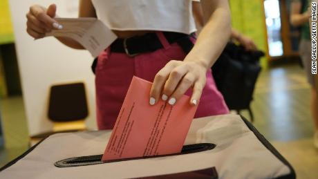 BERLIN, GERMANY - MAY 21: A voter casts her ballot in early voting at a local voting office in European parliamentary elections on May 21, 2019 in Berlin, Germany. Voters in European member states will go to the polls beginning Thursday in elections lasting through Sunday to elect a new European Parliament. In Germany voters can already cast their mail-in ballots by mail or in person at voting offices. Polling stations will open Sunday.  (Photo by Sean Gallup/Getty Images)