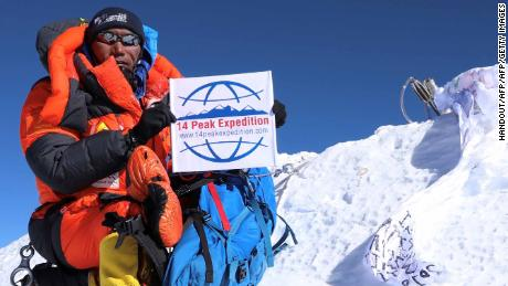 Kami Rita Sherpa, shown after scaling Everest for the 23rd time, completed a record 24th climb Tuesday.