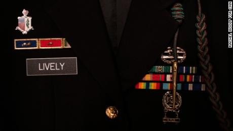 The badges and rank for Jordan Lively, a specialist in the US Army, are seen on his uniform.