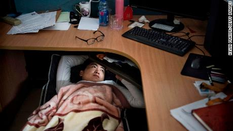 SHENZHEN, CHINA - APRIL 12: A Huawei employee watches a program on his smartphone as he rests at his cubicle during lunch break, which is known to be common practice in many workplaces in China, at the research and development area in the Bantian campus on April 12, 2019, in Shenzhen, China. Huawei is Chinas most valuable technology brand, and sells more telecommunications equipment than any other company in the world, with annual revenue topping $100 billion U.S.  Headquartered in the southern city of Shenzhen, considered Chinas Silicon Valley, Huawei has more than 180,000 employees worldwide, with nearly half of them engaged in research and development. In 2018, the company overtook Apple Inc. as the second largest manufacturer of smartphones in the world behind Samsung Electronics, a milestone that has made Huawei a source of national pride in China.While commercially successful and a dominant player in 5G, or fifth-generation networking technology, Huawei has faced political headwinds and allegations that its equipment includes so-called backdoors that the U.S. government perceives as a national security. U.S. authorities are also seeking the extradition of Huaweis Chief Financial Officer, Meng Wanzhou, to stand trial in the U.S. on fraud charges. Meng is currently under house arrest in Canada, though Huawei maintains the U.S. case against her is purely political. Despite the U.S. campaign against the company, Huawei is determined to lead the global charge toward adopting 5G wireless networks.  It has hired experts from foreign rivals, and invested heavily in R&D to patent key technologies to boost Chinese influence. (Photo by Kevin Frayer/Getty Images)