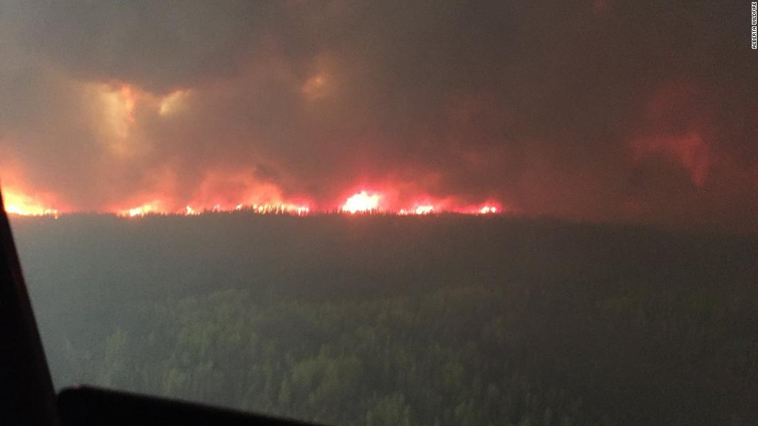 Wildfires force nearly 5,000 Canadians out of their homes as firefighters continue to battle growing blazes