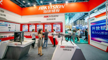 People visit the stand of the Hangzhou Hikvision Digital Technology during the 6th China Mobile Global Partner Conference in Guangzhou city, south China's Guangdong province, 6 December 2018.