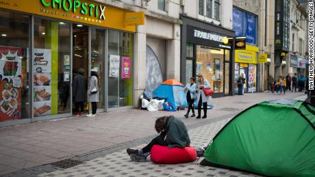 CARDIFF, UNITED KINGDOM - JANUARY 03: A man sits with his head in his hands in front of a tent on Queen Street on January 3, 2019 in Cardiff, United Kingdom. Nearly 600 homeless people in England and Wales died last year - a 24 percent rise over the past five years. Life expectancy is almost half that of people in stable housing, according to figures from the Office for National Statistics.(Photo by Matthew Horwood/Getty Images)