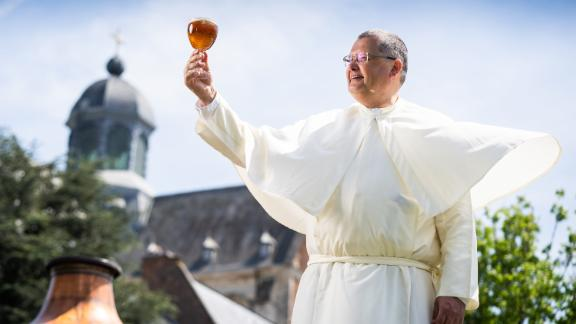 Grimbergen has revealed plans to build a new microbrewery inside the walls of Grimbergen Abbey near Brussels, which will combine modern techniques with brewing traditions from ancient books. Pictured is Father Karel Stautemas, subprior at Grimbergen Abbey, who is studying to be a brewer to join the microbrewery team.