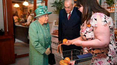 The Queen seemed to enjoy her visit to the 1860s style Sainsbury's store.