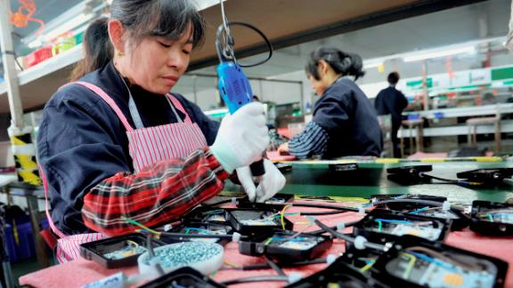 In this Saturday, March 30, 2019, file photo, workers assemble LED lights at a factory in Yushan county in central China's Jiangxi province. (AP Photo, File)