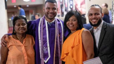 Frank Baez celebrates with his family after graduating Monday from New York University Rory Meyers College of Nursing. He posed with his grandmother Tomasina De los Santos, left, his mom, Santa Marte, and his older brother Juan Baez.