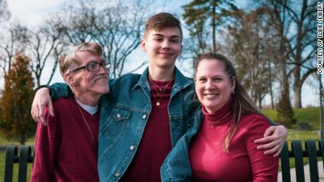 Elbie Seibert and his parents pose in April, shortly before his father's death.