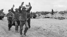 German prisoners are escorted along one of the Gold area beaches on D-Day.