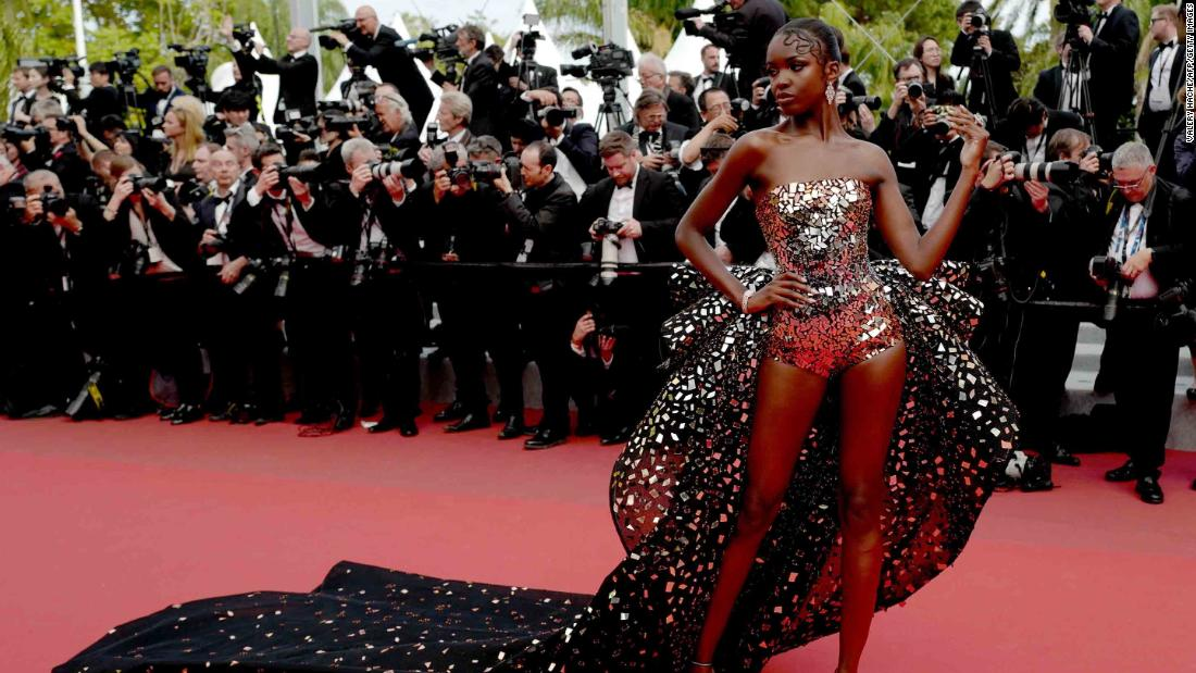 "Ahead of the ""Once Upon a Time... in Hollywood"" screening, British model Leomie Anderson strikes a pose in a mirror-embellished Rami Kadi gown."